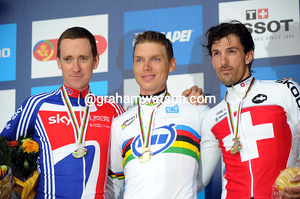 Tony Martin poses gracefully with a happy Bradley Wiggins and a very thoughtful Fabian Cancellara...