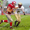 Bermudian Springs Eagle Tyler Fitzkee holds off Irish tackler. From Football 2011 09 09 Bermudian Springs 41 York Catholic 19.