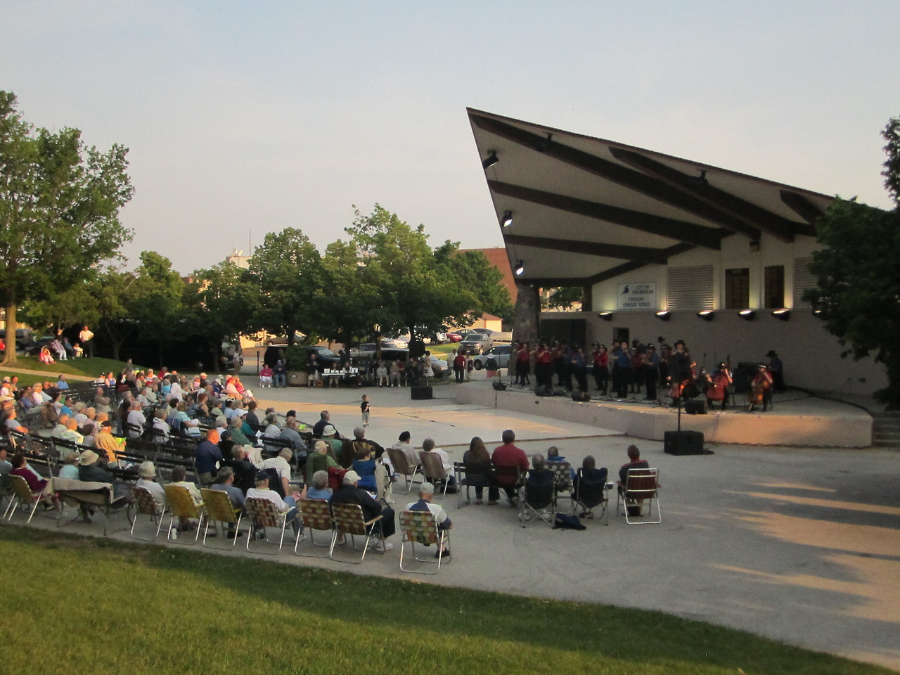 """Welcome to Sheboygan, Wisconsin Fountain Park Band shell Twilight Concert Series!  Another nice day and great performance venue for the Saline Fiddlers.  Friday Jul 1, 2011. <br /> Once again the crowd kept growing as people had to get closer to see America's premier youth fiddling showband. It was a beautiful evening and another great gig on the Land O Lakes Tour! The guestbook entries keep rolling in on Saline Fiddlers website. <a href=""""http://www.salinefiddlers.com/sfp/guestbook/"""">http://www.salinefiddlers.com/sfp/guestbook/</a><br />  Also visit Sheboygan at <a href=""""http://www.visitsheboygan.com/"""">http://www.visitsheboygan.com/</a> Photos credit Kevin Carnahan, Bob Remenapp and Ben Culver"""