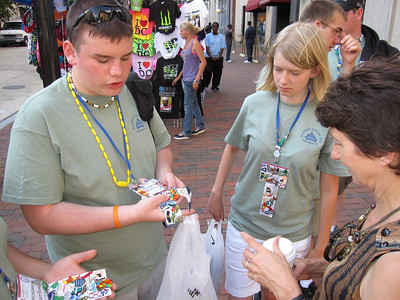 Tyler is explaining to Linda about the pin and sticker trading between states.