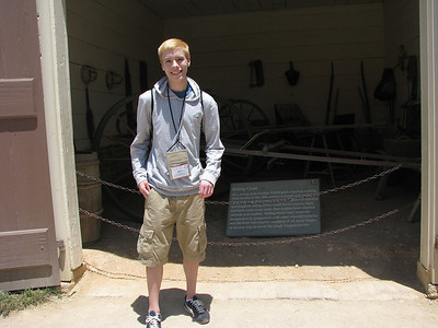 Levi striking a pose in front of George Washington's riding carriage.