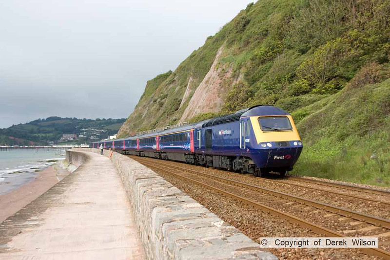 110625-001     FGW class 43 no 43098 & 43121 provide the power for the  07.47 Plymouth-London, Paddington, seen passing the sea wall at Teignmouth.