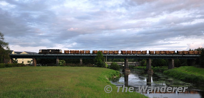 076 cross the Barrow Bridge at Monastervin with the 1655 Westport - Waterford laden Timber. Fri 10.06.11