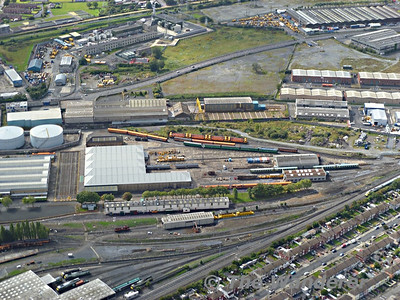 The west end of Inchicore showing the carriage shops, the paint shop and wheel lathe building. 3 Autoballaster wagons can be seen at the west end of the wheel lathe building, while in the back round stored 201 locos and the RPSI Wooden Bodied rake of carriages are visible.  Sat 27.08.11