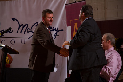 John McCloskey, Jr. shakes hands with Alvernia University President, Dr. Tom Flynn following remarks to a capacity crowd at the Physical Education Center as Alvernia University officially named the gym floor Jack McCloskey Court after former head men's basketball coach, Jack McCloskey.