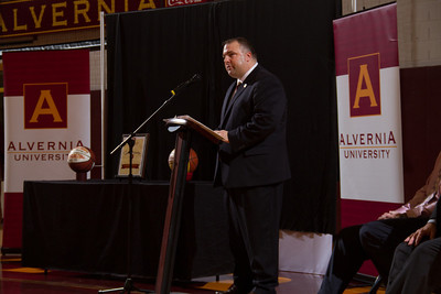 Alvernia University Director of Athletics Bill Stiles delivers a welcome to a capacity crowd at the Physical Education Center as Alvernia University officially named the gym floor Jack McCloskey Court after former head men's basketball coach, Jack McCloskey.