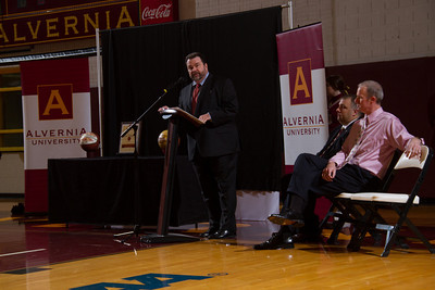 Alvernia University President, Dr. Tom Flynn, addresses a capacity crowd at the Physical Education Center as Alvernia University officially named the gym floor Jack McCloskey Court after former head men's basketball coach, Jack McCloskey.  To his left are Athletic Director Bill Stiles and former men's basketball player Art Schomp (1992-95).