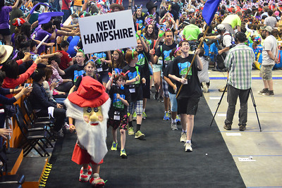 Representatives of Team New Hampshire enter the Thompson-Boling Arena at Opening Ceremony of Destination Imagination Global Finals 2013.