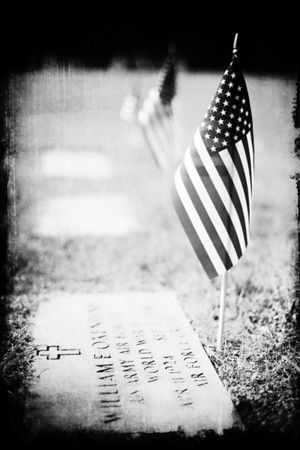 22/52 - I went to a few cemeteries today to photograph American flags placed on the graves of veterans for the Memorial Holiday. Sadly, I found very few. At one cemetery I saw just one and the cemetery in this shot had just three. I wish I had taken some flags with me to place on the graves of the forgotten.  I wasn't too happy with the color version of this shot, so I added a texture to it and converted it to black & white.