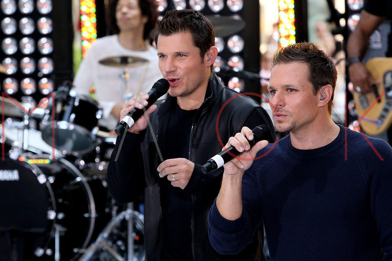 """NEW YORK, NY - AUGUST 17:  Nick Lachey and Drew Lachey of 98 Degrees perform on NBC's """"Today"""" at Rockefeller Plaza on August 17, 2012 in New York City.  (Photo by Steve Mack/S.D. Mack Pictures)"""