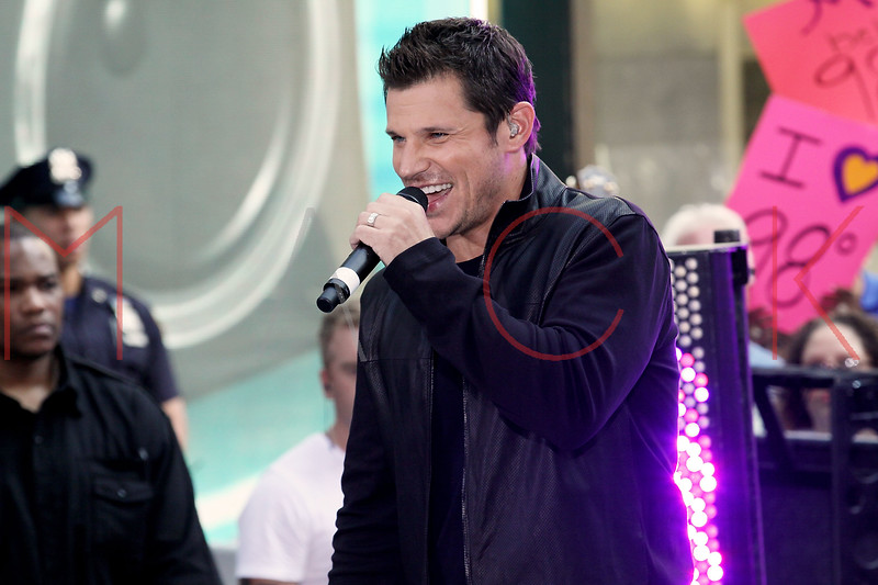 "NEW YORK, NY - AUGUST 17:  Nick Lachey of 98 Degrees performs on NBC's ""Today"" at Rockefeller Plaza on August 17, 2012 in New York City.  (Photo by Steve Mack/S.D. Mack Pictures)"