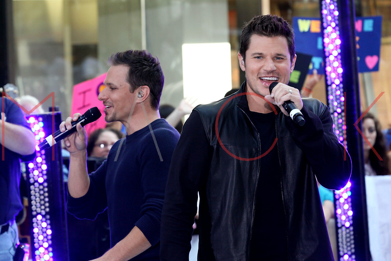 """NEW YORK, NY - AUGUST 17:  Drew Lachey and Nick Lachey of 98 Degrees perform on NBC's """"Today"""" at Rockefeller Plaza on August 17, 2012 in New York City.  (Photo by Steve Mack/S.D. Mack Pictures)"""