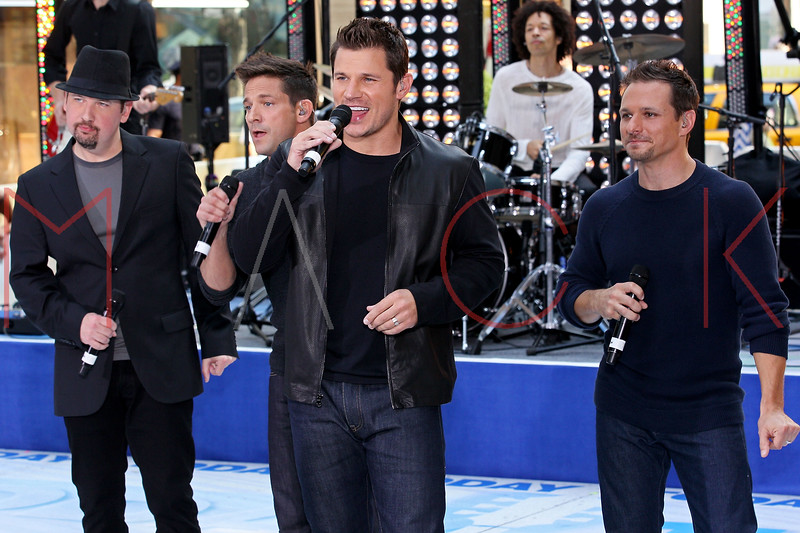 """NEW YORK, NY - AUGUST 17:  Jeff Timmons, Justin Jeffre, Nick Lachey and Drew Lachey of 98 Degrees perform on NBC's """"Today"""" at Rockefeller Plaza on August 17, 2012 in New York City.  (Photo by Steve Mack/S.D. Mack Pictures)"""
