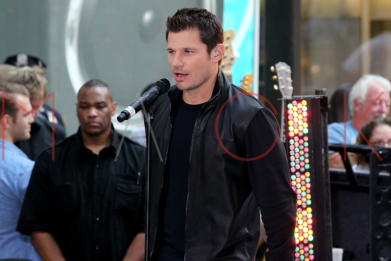 """NEW YORK, NY - AUGUST 17:  Nick Lachey of 98 Degrees performs on NBC's """"Today"""" at Rockefeller Plaza on August 17, 2012 in New York City.  (Photo by Steve Mack/S.D. Mack Pictures)"""
