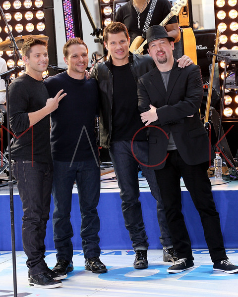 """NEW YORK, NY - AUGUST 17:  Justin Jeffre, Drew Lachey, Nick Lachey and Jeff Timmons of 98 Degrees perform on NBC's """"Today"""" at Rockefeller Plaza on August 17, 2012 in New York City.  (Photo by Steve Mack/S.D. Mack Pictures)"""