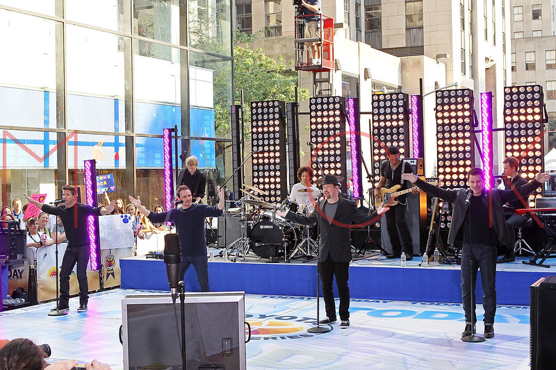 "NEW YORK, NY - AUGUST 17:  Justin Jeffre, Drew Lachey, Jeff Timmons and Nick Lachey of 98 Degrees perform on NBC's ""Today"" at Rockefeller Plaza on August 17, 2012 in New York City.  (Photo by Steve Mack/S.D. Mack Pictures)"