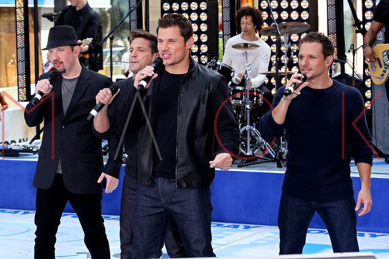 "NEW YORK, NY - AUGUST 17:  Jeff Timmons, Justin Jeffre, Nick Lachey and Drew Lachey of 98 Degrees perform on NBC's ""Today"" at Rockefeller Plaza on August 17, 2012 in New York City.  (Photo by Steve Mack/S.D. Mack Pictures)"