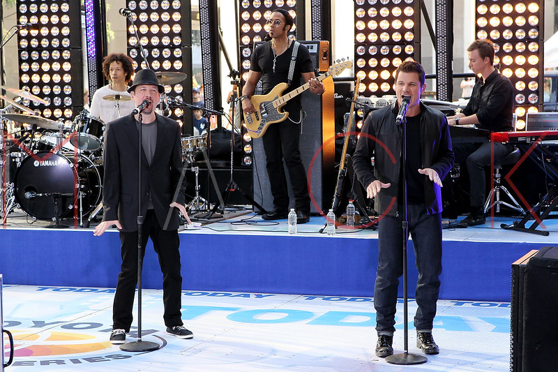 """NEW YORK, NY - AUGUST 17:  Jeff Timmons and Nick Lachey of 98 Degrees perform on NBC's """"Today"""" at Rockefeller Plaza on August 17, 2012 in New York City.  (Photo by Steve Mack/S.D. Mack Pictures)"""