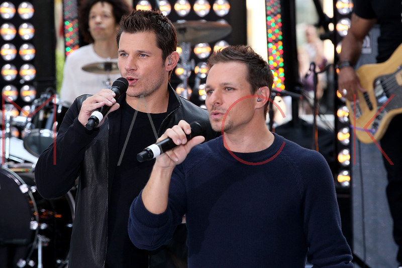 "NEW YORK, NY - AUGUST 17:  Nick Lachey and Drew Lachey of 98 Degrees perform on NBC's ""Today"" at Rockefeller Plaza on August 17, 2012 in New York City.  (Photo by Steve Mack/S.D. Mack Pictures)"