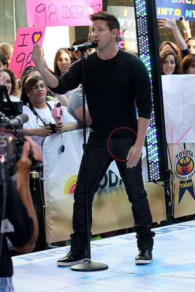 """NEW YORK, NY - AUGUST 17:  Justin Jeffre of 98 Degrees performs on NBC's """"Today"""" at Rockefeller Plaza on August 17, 2012 in New York City.  (Photo by Steve Mack/S.D. Mack Pictures)"""