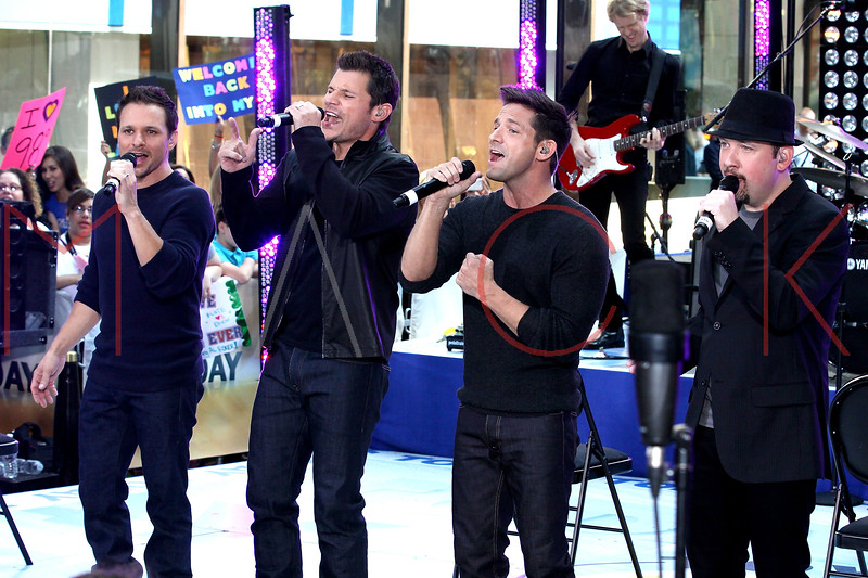 """NEW YORK, NY - AUGUST 17:  Drew Lachey, Nick Lachey, Justin Jeffre and Jeff Timmons of 98 Degrees perform on NBC's """"Today"""" at Rockefeller Plaza on August 17, 2012 in New York City.  (Photo by Steve Mack/S.D. Mack Pictures)"""