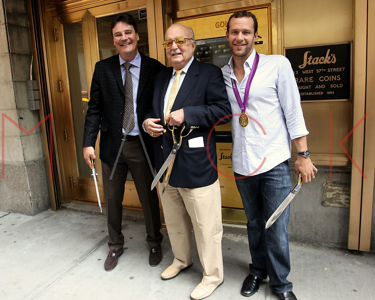 NEW YORK, NY - AUGUST 23:  Greg Roberts, Harvey G. Stack and 6-Time Olympic Gold medalist swimmer Brendan Hansen cut the ribbon at the grand re-opening of Stack's Bowers Galleries on August 23, 2012 in New York City.  (Photo by Steve Mack/S.D. Mack Pictures)