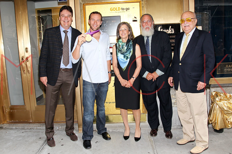 NEW YORK, NY - AUGUST 23:  Greg Roberts, 6-Time Olympic Gold medalist swimmer Brendon Hanson, Renee Ring, Larry Stack and Harvey Stack attend the grand re-opening of Stack's Bowers Galleries on August 23, 2012 in New York City.  (Photo by Steve Mack/S.D. Mack Pictures)