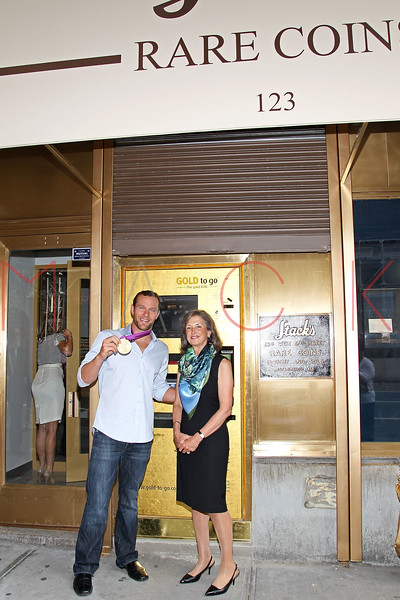 NEW YORK, NY - AUGUST 23:  6-Time Olympic Gold medalist swimmer Brendon Hanson and Renee Ring attend the grand re-opening of Stack's Bowers Galleries on August 23, 2012 in New York City.  (Photo by Steve Mack/S.D. Mack Pictures)