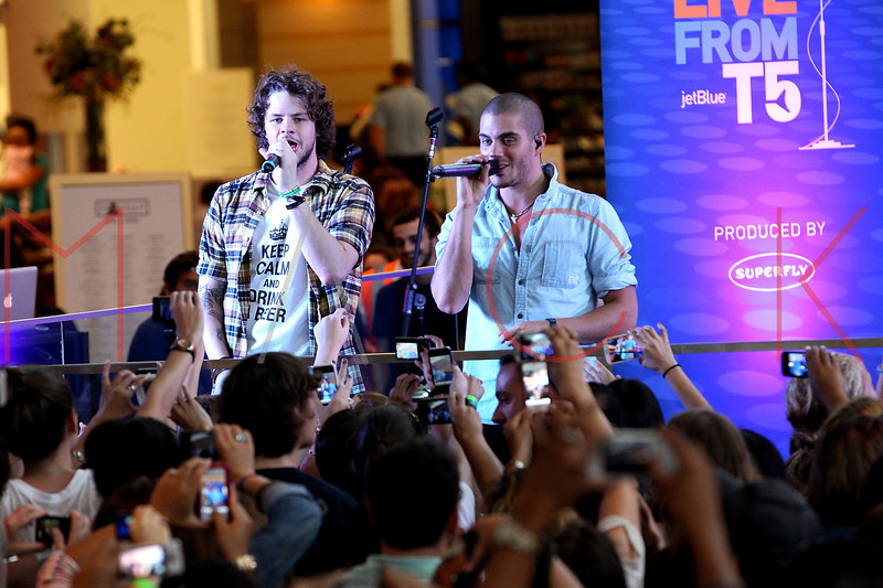 NEW YORK, NY - AUGUST 22:  Jay McGuiness and Max George perform during JetBlue's Live From T5 Concert Series at John F. Kennedy International Airport on August 22, 2012 in the Queens borough of New York City.  (Photo by Steve Mack/S.D. Mack Pictures)