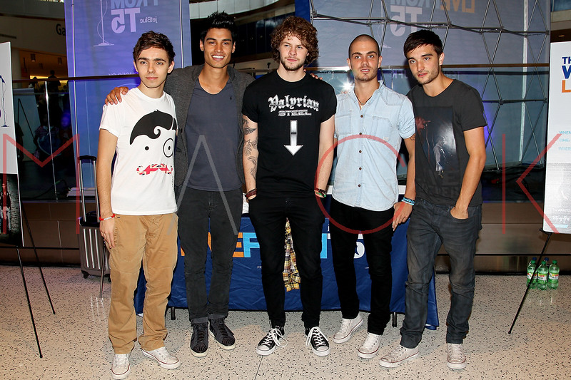 NEW YORK, NY - AUGUST 22:  Nathan Sykes, Siva Kaneswaran, Jay McGuiness, Max George and Tom Parker of the band The Wanted pose for pictures before performing during JetBlue's Live From T5 Concert Series at John F. Kennedy International Airport on August 22, 2012 in the Queens borough of New York City.  (Photo by Steve Mack/S.D. Mack Pictures)