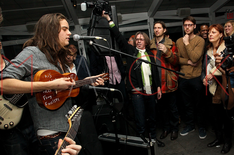 NEW YORK, NY - DECEMBER 15:  Jack Robbins performs for an audiance including his mother Susan Sarandon (R) at Hurricane Sandy Toys For Tots Benefit hosted by Boss Models And Barbie Blank on December 15, 2012 in New York, United States.  (Photo by Steve Mack/S.D. Mack Pictures)