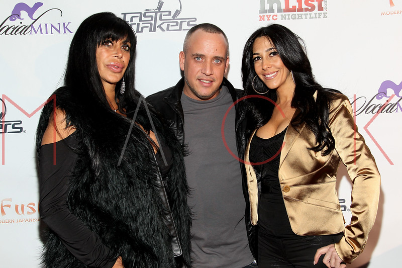 NEW YORK, NY - FEBRUARY 17:  TV personalities Angela 'Big Ang' Raiola (L) and Carla Facciolo (R) of reality TV series 'Mob Wives' pose with VJ Sizzahandz (M) at the Fushimi Williamsburg opening on February 17, 2012 in the Brooklyn Borough of New York City.  (Photo by Steve Mack/S.D. Mack Pictures)