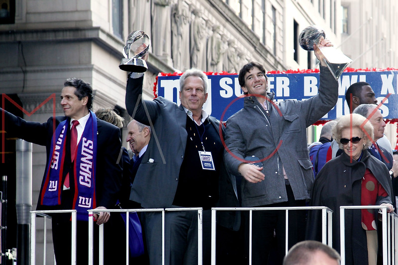 NEW YORK, NY - FEBRUARY 07:  New York Giants Quarterback Eli Manning (R) holds the Vince Lombardi Trophy attends the New York Giants Victory Parade following their Super Bowl XLVI win down the Canyon of Heroes on the streets of Manhattan on February 7, 2012 in New York City.  (Photo by Steve Mack/S.D. Mack Pictures)