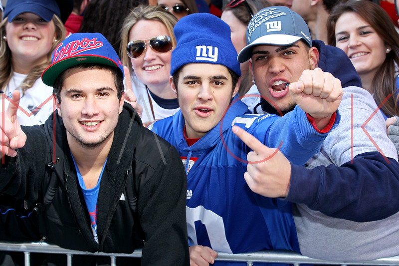NEW YORK, NY - FEBRUARY 07:  Fans attend the New York Giants Victory Parade following their Super Bowl XLVI win down the Canyon of Heroes on the streets of Manhattan on February 7, 2012 in New York City.  (Photo by Steve Mack/S.D. Mack Pictures)