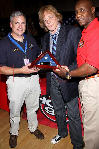 NEW YORK, NY - JULY 01:  Fort Hamilton Garrison Commander Colonel Michael J. Gould, Eddie Money and Command Sgt. Maj. Hector A. Prince attend a meet and greet during a free Independence Day concert and fireworks display at 101st Street and Ft. Hamilton Parkway on July 1, 2012 in the Brooklyn borough of New York City.  (Photo by Steve Mack/S.D. Mack Pictures)