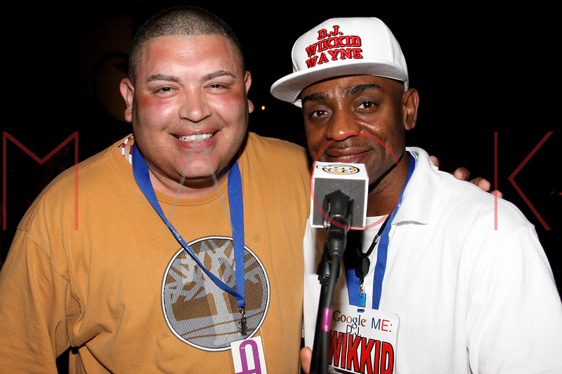 NEW YORK, NY - JULY 01:  MC Danny Santiago and DJ Wickkid Wayne back stage during a free Independence Day concert and fireworks display at 101st Street and Ft. Hamilton Parkway on July 1, 2012 in the Brooklyn borough of New York City.  (Photo by Steve Mack/S.D. Mack Pictures)