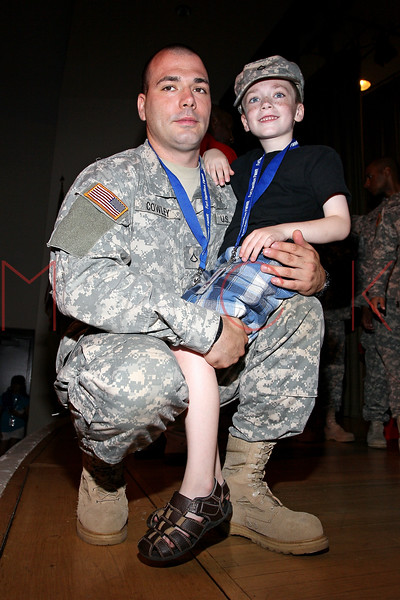 NEW YORK, NY - JULY 01:  Pfc. Cowley and his son Anthony attend a meet and greet during a free Independence Day concert and fireworks display at 101st Street and Ft. Hamilton Parkway on July 1, 2012 in the Brooklyn borough of New York City.  (Photo by Steve Mack/S.D. Mack Pictures)