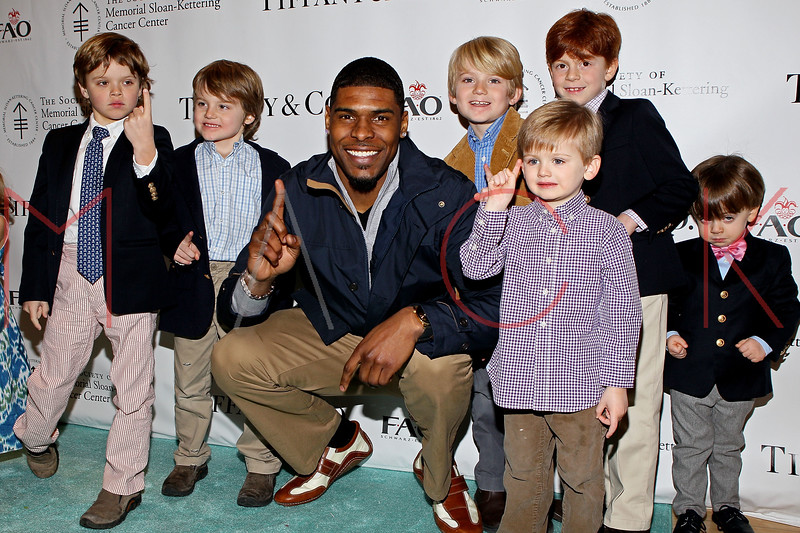 NEW YORK, NY - MARCH 06:  Wide Receiver for the NY Giants Ramses Barden (middle) attends the 21st Annual Bunny Hop at FAO Schwarz on March 6, 2012 in New York City.  (Photo by Steve Mack/S.D. Mack Pictures)