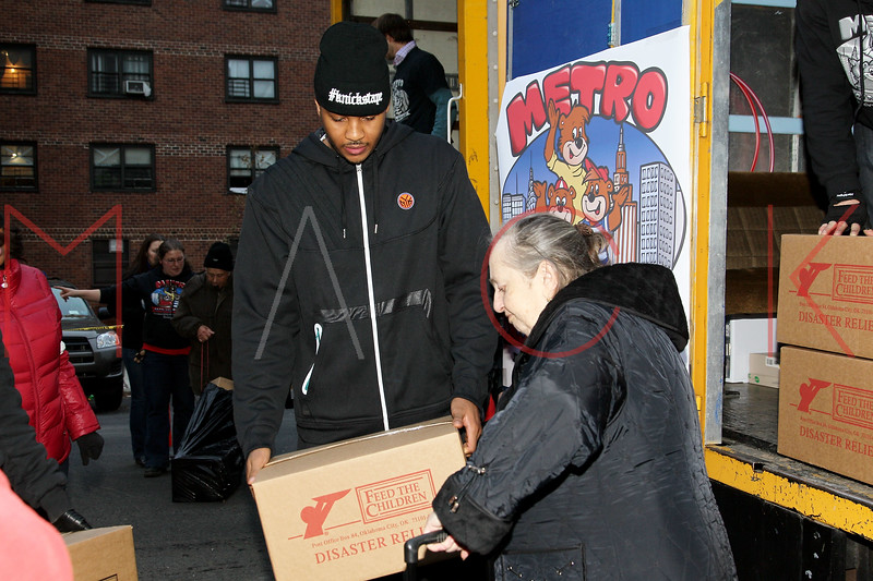 NEW YORK, NY - NOVEMBER 10:  Carmelo Anthony handing out food on November 10, 2012 in New York City.  (Photo by Steve Mack/S.D. Mack Pictures)