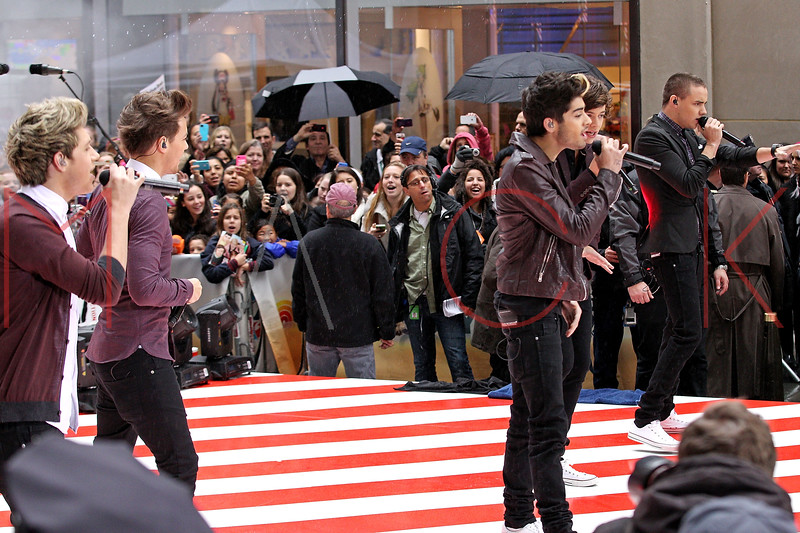 """NEW YORK, NY - NOVEMBER 13:  One Direction performs on NBC's """"Today"""" at Rockefeller Plaza on November 13, 2012 in New York City.  (Photo by Steve Mack/S.D. Mack Pictures)"""