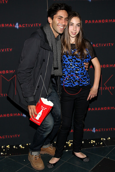 "NEW YORK, NY - OCTOBER 16:  Yaniv ÒNevÓ Schulman and Julia Barash attend the ""Paranormal Activity 4"" screening at Regal E-Walk Stadium 13 on October 16, 2012 in New York City.  (Photo by Steve Mack/S.D. Mack Pictures)"