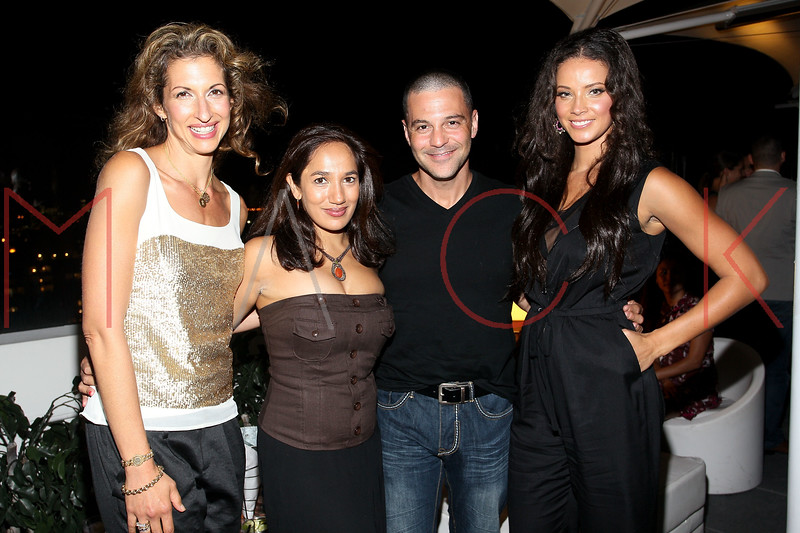 NEW YORK, NY - SEPTEMBER 06:  Alysia Reiner, Purva Bedi, David Allen Basche and Porschla Coles at Sky Room on September 6, 2012 in New York City.  (Photo by Steve Mack/Getty Images for Caravan)