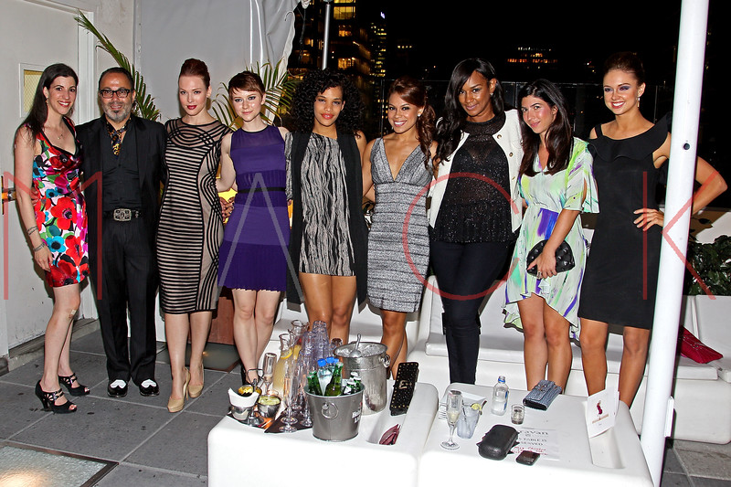 NEW YORK, NY - SEPTEMBER 06:  Erica Wolf, Christo, Erin Cummings, Valorie Curry, guest, Toni Trucks, Jackie Christie, Claudine DeSola and Chambers Steedle at Sky Room on September 6, 2012 in New York City.  (Photo by Steve Mack/Getty Images for Caravan)