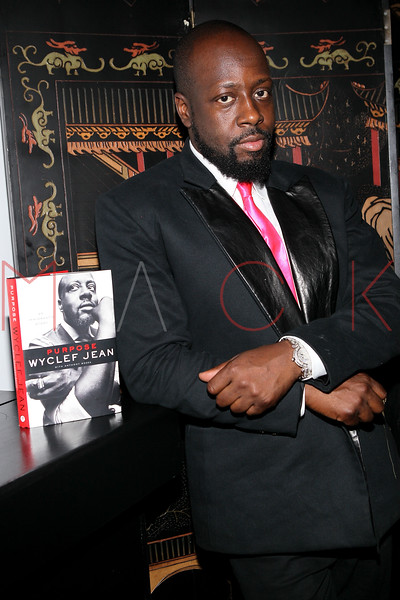 "NEW YORK, NY - SEPTEMBER 14:  Wyclef Jean poses with his new book ""Purpose"" Wyclef Jean at HK Lounge on September 14, 2012 in New York City.  (Photo by Steve Mack/S.D. Mack Pictures)"