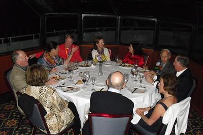 Vic & Roz Simon, Steve & Lynn Scott, Tom & Janet McCulloch, Syd & Judianne Traum and Howard & Ann Port all talk over dinner while sailing the Intercoastal.