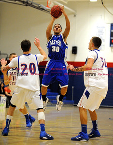1/15/2011 Mike Orazzi | Staff Bristol Eastern's Elisas Rodriguez (3) at Plainville High School on Saturday night.