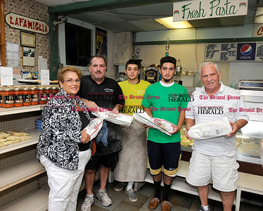 8/1/2012 Mike Orazzi | Staff Members of the Nicoletti family, left to right: Fran, Tony Jr., Tony III, Gino and Tony Sr. at La Famiglia on Farmington Avenue in Bristol on Wednesday.  *** for a Lluvia ***