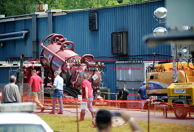 8/1/2012 Mike Orazzi   Staff Clean up crews on the scene of the fire at Rex Forge on Wednesday morning.