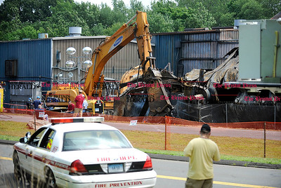 8/1/2012 Mike Orazzi | Staff Clean up crews on the scene of the fire at Rex Forge on Wednesday morning.