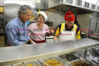 12/1/2012 Mike Orazzi | Staff Don Soucy, Karen Vibert and Harley Graime work in the kitchen during the Secret Santa Society breakfast at the Giamatti Little League Center on Saturday morning in Bristol.